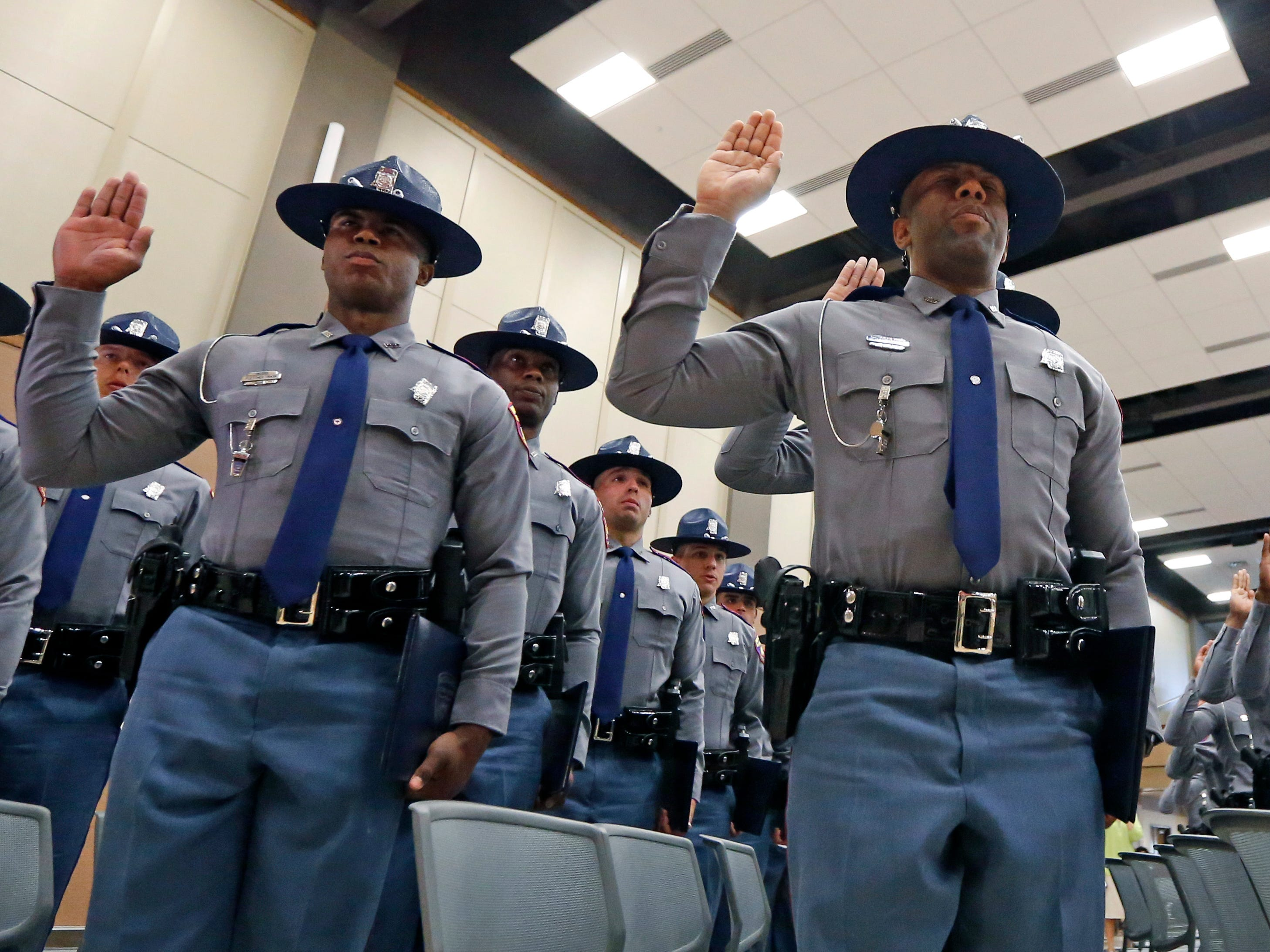 Members of the Mississippi Highway Safety Patrol Cadet Class 63 recite their oath of office in the Clyde Muse Center in Pearl, Miss., as they were sworn in as the newest Patrol troopers, Wednesday, May 1, 2019. The patrol's training lasts 22 weeks and involves classroom instruction, physical fitness, firearms and emergency operations training as well as a variety of police science courses.