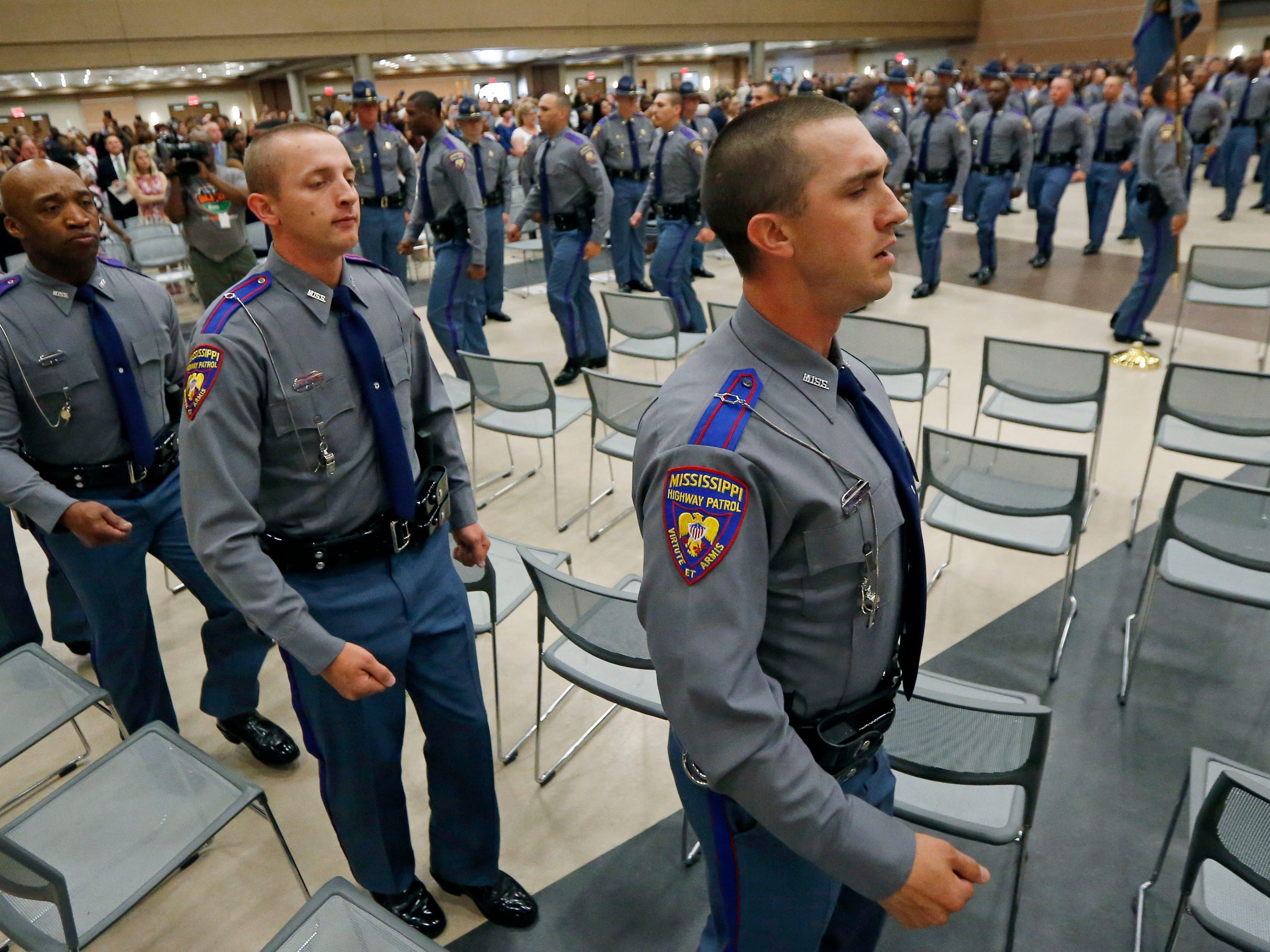 Members of the Mississippi Highway Safety Patrol Cadet Class 63 march into the Clyde Muse Center in Pearl, Miss., where in front of family, friends, lawmen and lawmakers, they will be sworn in as the newest Mississippi Highway Patrol troopers, Wednesday, May 1, 2019.