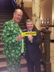 "David Singletary, wearing a marijuana suit, stands with state Rep. Lester ""Bubba"" Carpenter, R-Burnsville, at the Mississippi Capitol earlier this year. Singletary said he often visits the Legislature during the session to talk with officials about marijuana legalization."