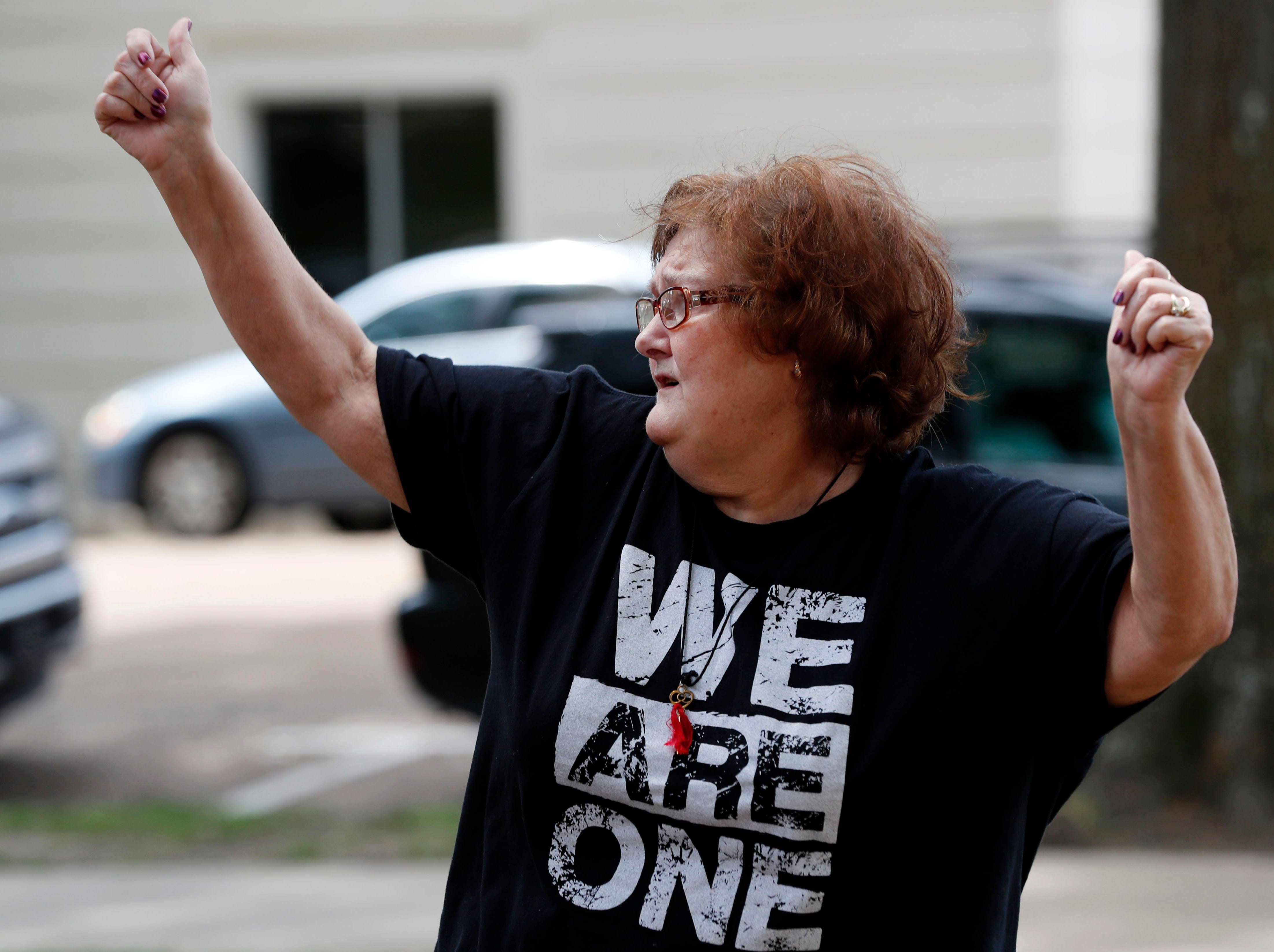 Susan Nall of Canton, Miss., waves her arms during a dance of joy on the grounds of the state Capitol in Jackson, Miss., Thursday, May 2, 2019, during the National Day of Prayer. The annual day of observance is held on the first Thursday of May, designated by the United States Congress, calling on all people of faith to pray for the nation and its leaders. (AP Photo/Rogelio V. Solis)