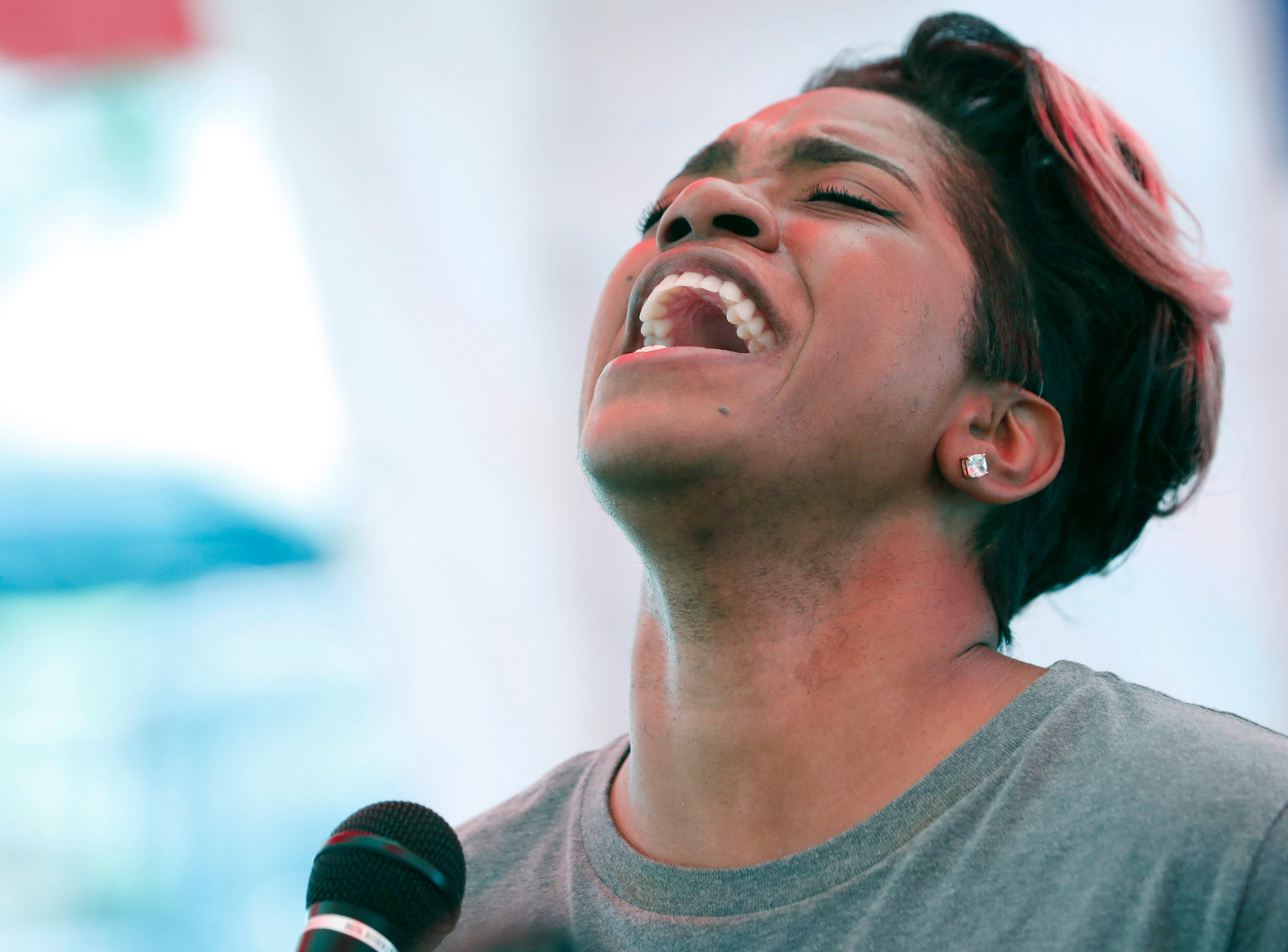 Tabitha Thompson of the Word of Life church choir in Flowood, Miss., sings about the glory of God at the state Capitol in Jackson, Miss., Thursday, May 2, 2019, during the National Day of Prayer. The annual day of observance is held on the first Thursday of May, designated by the United States Congress, and calling on all people of faith to pray for the nation and its leaders. (AP Photo/Rogelio V. Solis)