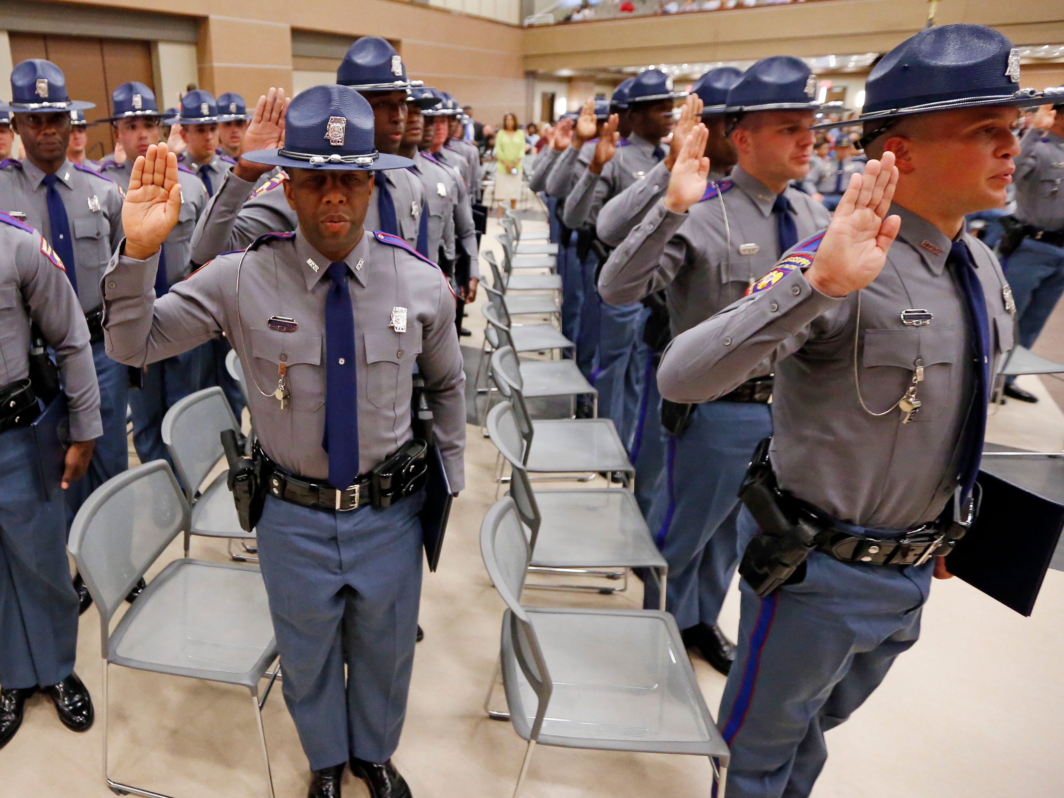 Members of the Mississippi Highway Safety Patrol Cadet Class 63 recite their oath of office in the Clyde Muse Center in Pearl, Miss., as they were sworn in as the newest Patrol troopers, Wednesday, May 1, 2019.