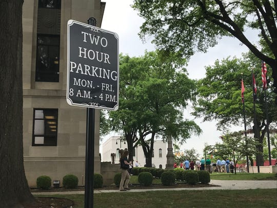 A two-hour parking sign stands in front of Madison County Court House in downtown Jackson. Two-hour limits on parking spaces have become harder to enforce after federal judges ruled tire chalking unconstitutional.