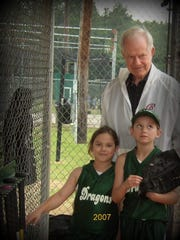 On right, Aubrey Leach, 9, with her sister Kelcy, 7, and grandfather Lynn in 2007.