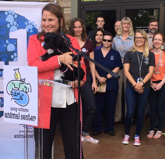 "Janet Testerman, CEO of Young-Williams Animal Center, announced on Thursday, May 2, 2019,  that Young-Williams saved 8,311 pets in 2018 and achieved ""no-kill"" status for the first time in the shelter's history. Young-Williams staff watched in the background."