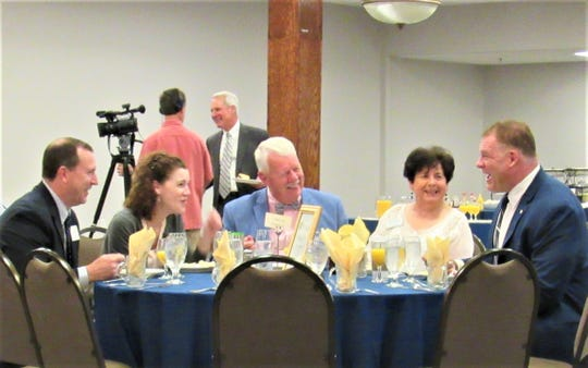 Sharing a table and a laugh at the FWKCC Breakfast Speaker Series on April 30, David Smoak, Louise Povlin, Ron Williams, TC Williams and Glenn Jacobs also share the common purpose of promoting smart growth throughout our region.