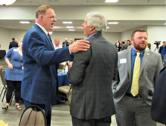 Knox County Mayor Glenn Jacobs greets 5th District County Commissioner John Schoonmaker while Bryan Hair, Jacobs' chief of staff, works the room.