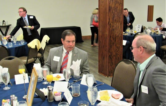 Knox County Sheriff Tom Spangler confers with security expert Mike Tidwell at the Chamber breakfast on April 30 at Rothchild Center.