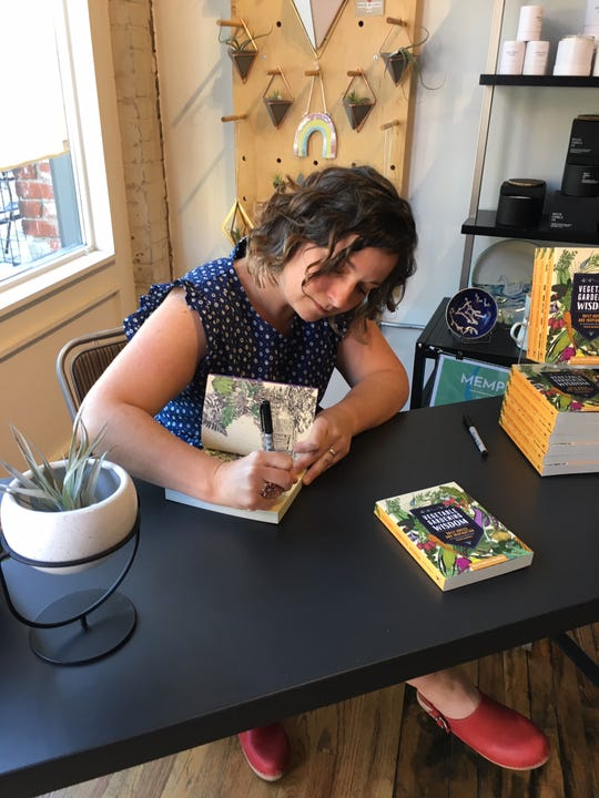 """Kelly Smith Trimble signs copies of her new book, """"Vegetable Garden Wisdom,"""" at Rala in the Old City. April 27, 2019."""