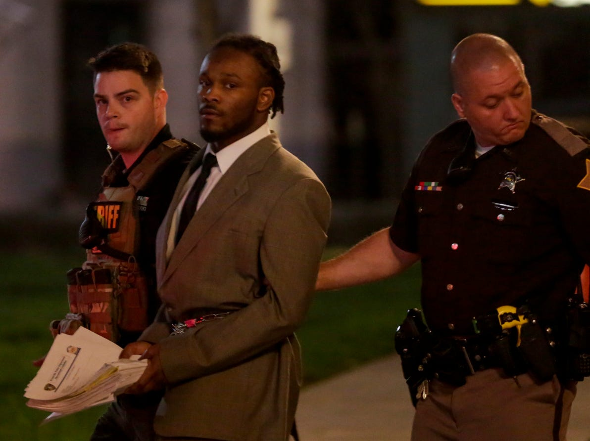 Deshay Hackner is escorted out of the Tippecanoe County Courthouse by sheriff's deputies after jurors delivered a guilty verdict in the Oct. 2017 killings of Dewone Broomfield and Mary Woodruff, Wednesday, May 1, 2019 in Lafayette.