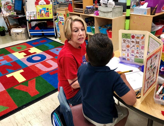 Kim Bourgeois works on pronunciation with a student in her kindergarten ESL class at Broadmoor Elementary School in Lafayette.
