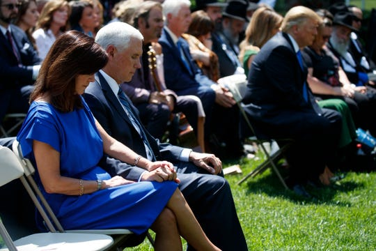 Vice President Mike Pence and Karen Pence pray during a National Day of Prayer event with President Donald Trump in the Rose Garden of the White House, Thursday, May 2, 2019, in Washington. (AP Photo/Evan Vucci)