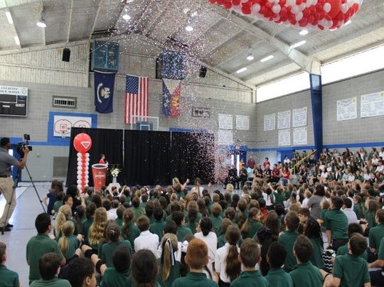 Sts. Leo-Seton Catholic School was the top earner in Community's Cash for Schools program for the second year in a row and earned the most funds for a single school in the history of the program. Students celebrate with confetti and red and white balloons Wednesday.