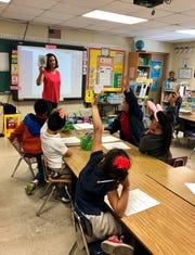First-grade ESL teacher Laura Blossom uses flash cards in her phonics lesson at Broadmoor Elementary School in Lafayette.