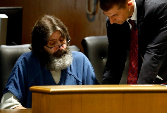 Timothy Hicks, left, listens as his attorney Brian Joslyn explains waiver forms for Hicks to sign Wednesday afternoon, May 2, 2019, in Fairfield County Common Pleas Court in Lancaster. Hicks was sentenced to nine years in prison for dealing methamphetamine. Hicks was also sent to prison for 24 months for violating his community control in a 2017 case. He also faces potential penalties for violating his community control in a 2017 case in Marion County.