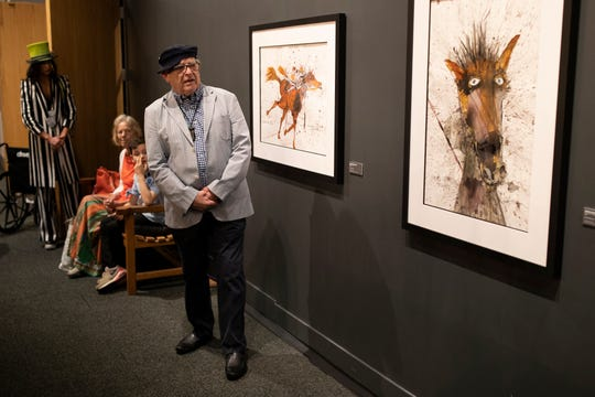 Artist Ralph Steadman looks over his works and talks with visitors in the Kentucky Derby Museum. May 2, 2019