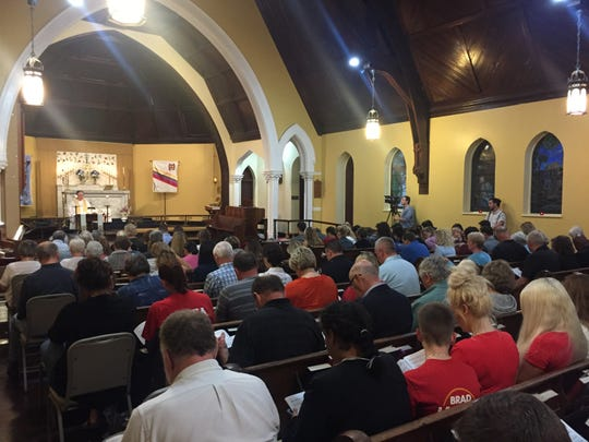 More than 100 people gathered Wednesday at St. Paul's Episcopal Church in Jeffersonville, Indiana, to pray for Judges Andrew Adams and Bradley Jacobs.