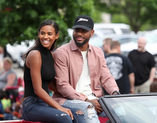 Bryson Tiller and girlfriend Kendra Bailey ride down Broadway in Louisville during the 2019 Pegasus Parade. The two are expecting a daughter.