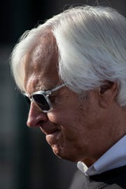 Trainer Bob Baffert ponders a question outside his barn on the backside of Churchill Downs.  Baffert has three horses in the Kentucky Derby, Improbable, Roadster and Game Winner. May 2, 2019.