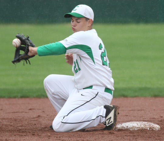 Clear Fork's Kaleb Hollar picks a throw to second during the Colts' 4-3 win over Pleasant on Thursday.