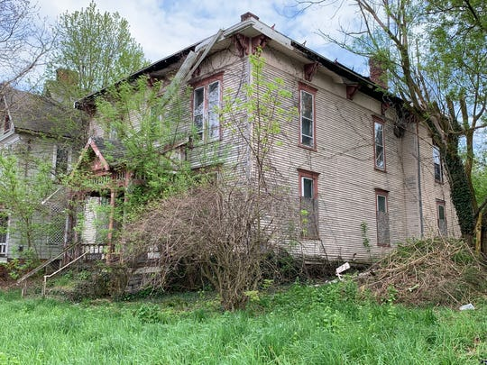 171 West Fourth Street was slated for demolition by the city of Mansfield. Then the Ohio State Historic Preservation Office recommended the house, which belonged to Jacob Laird, be individually eligible for listing in the National Register of Historic Places.