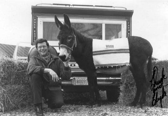 Above is an autographed photo taken in 1975 of WMRN Radio personality Charlie Evers with Homestead Clyde. The donkey came to him when someone, apparently as a prank, left it tied to the bumper of his truck, seen in the background, with some straw, hay, a sombrero and a Mexican blanket.