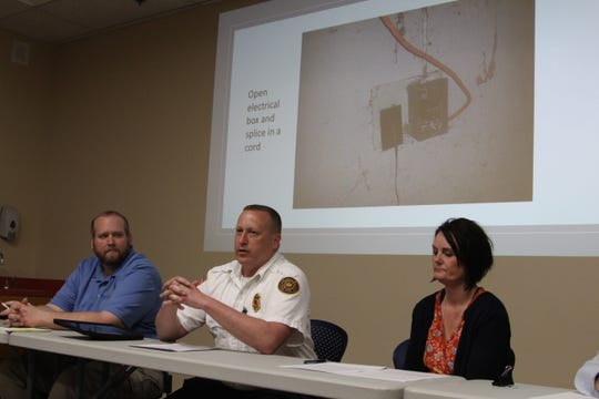 Marion City Fire Inspector Mike Makowski, center, calls for a residential building department to enforce building codes for houses at a panel to discuss housing in Marion Wednesday.