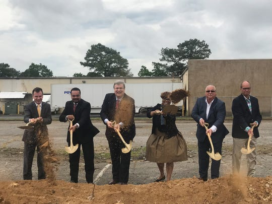 From left, John Lawrence from the Economic Development Growth Engine of Memphis and Shelby County; Trey McKnight of the Whitehaven Development Corp.; Memphis Mayor Jim Strickland; Beverly Robertson, president and CEO of the Greater Memphis Chamber; and Power Transport founders Tony Maranise and Mitchell Spurlock gather to celebrate the groundbreaking for construction on Power Transport's new Whitehaven headquarters at 3036 Directors Row.