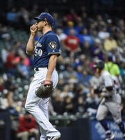 Brewers pitcher Jacob Barnes reacts after giving up a three run home run to Colorado Rockies third baseman Nolan Arenado in the first inning.