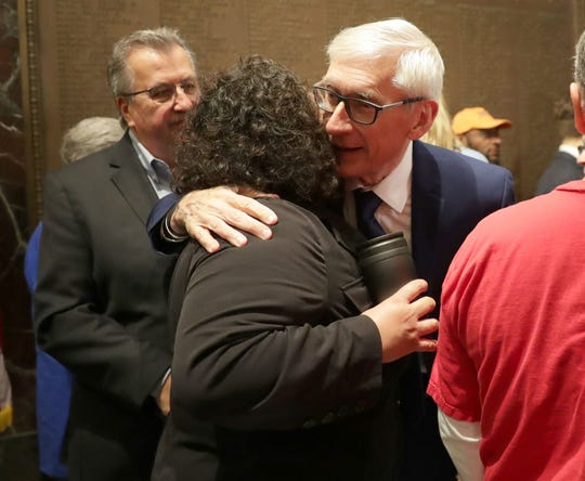Gov. Tony Evers hugs a supporter after a May news conference regarding Medicaid expansion.