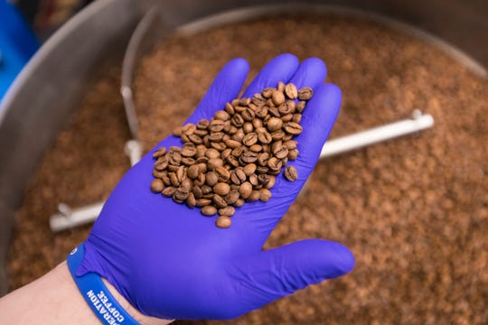 Sam Floyd looks to remove coffee beans that would detract from the flavor profile he is creating at his coffee roasting business, Operation Coffee.