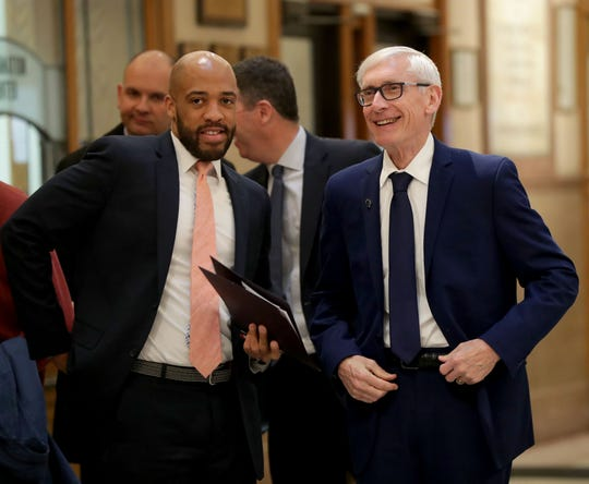 Gov. Tony Evers (right) and Lt. Gov. Mandela Barnes arrive before holding a news conference regarding Medicaid expansion.