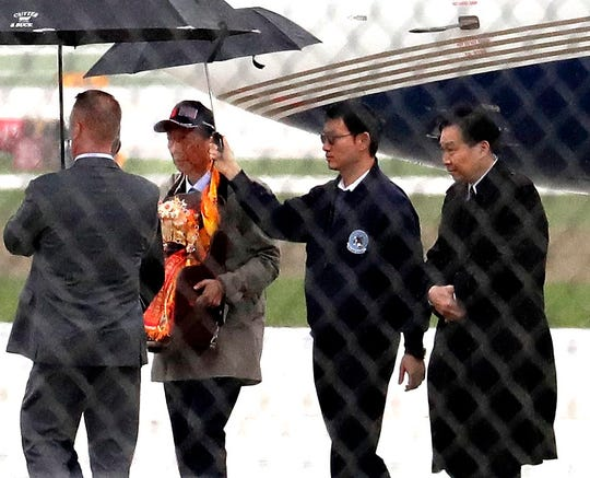 Foxconn Technology Group CEO Terry Gou (wearing cap) arrives at Signature Flight Services at Milwaukee Mitchell International Airport to meet with Wisconsin Gov. Tony Evers Thursday.
