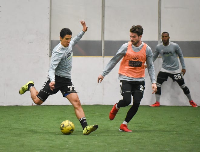 Defender Marcio Leite takes a shot against midfielder Andrew Wiedabach during Milwaukee Wave practice this week at Uihlein Soccer Park. The team was preparing to play the Monterrey Flash for the MASL championship.