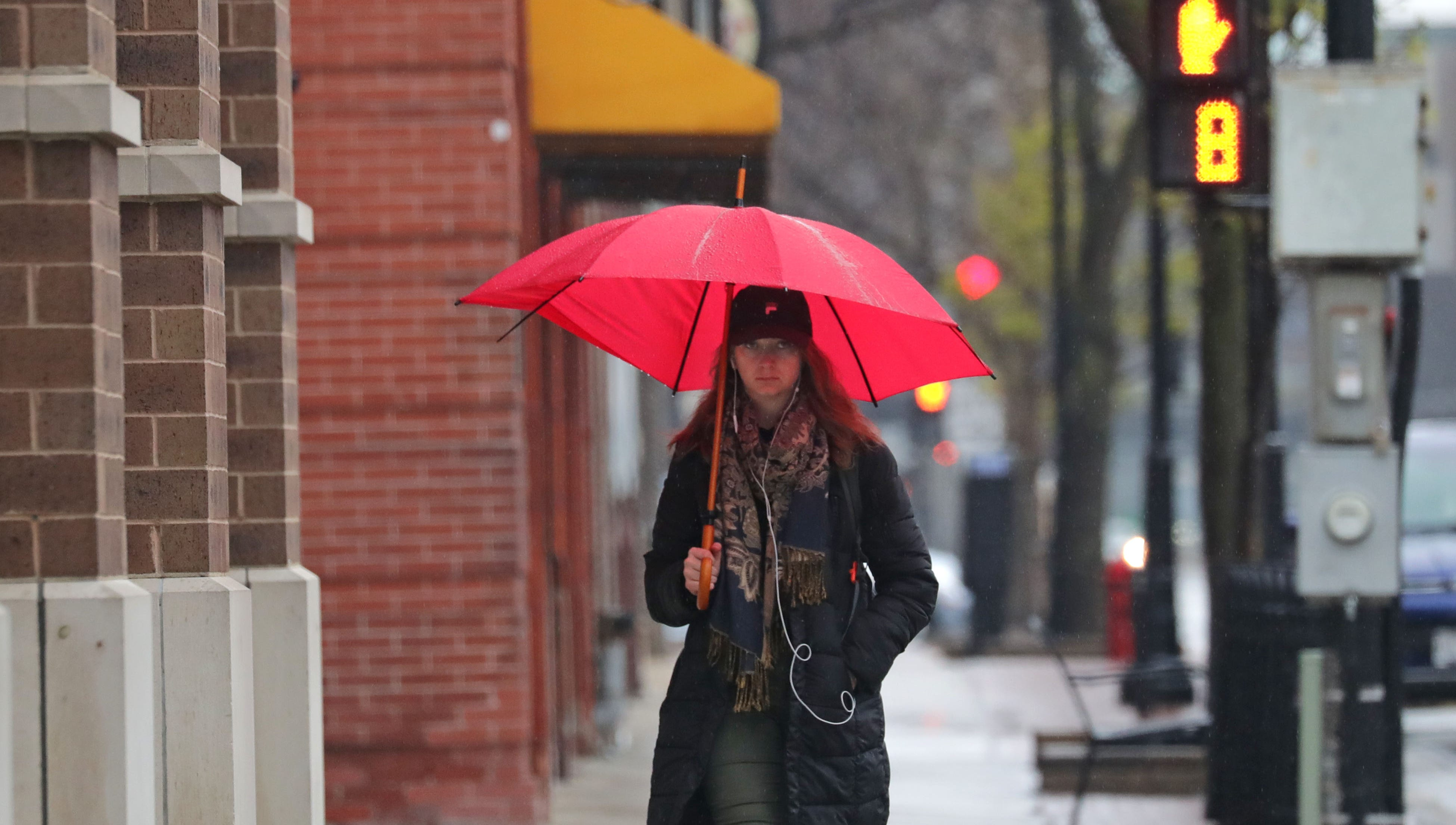 Samantha Bilgrien, of the Milwaukee walks in the rain on her way to work down North Old World 3rd Street near W. Highland Ave. in Milwaukee on Thursday, May 2, 2019. Weather Photo by Mike De Sisti/Milwaukee Journal Sentinel