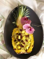 Cilantro Pineapple Rice is pretty served in a pineapple boat, with or without diced Chinese sausages on top.