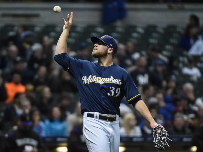 Pitcher Corbin Burnes, who was recalled from Class AAA just prior to the Brewers' game against the Rockies on Wednesday, gets a new baseball after giving up a run during the sixth inning. After pitching a 1-2-3 fifth inning, Burnes was tagged for three runs on three hits with two walks in the sixth.