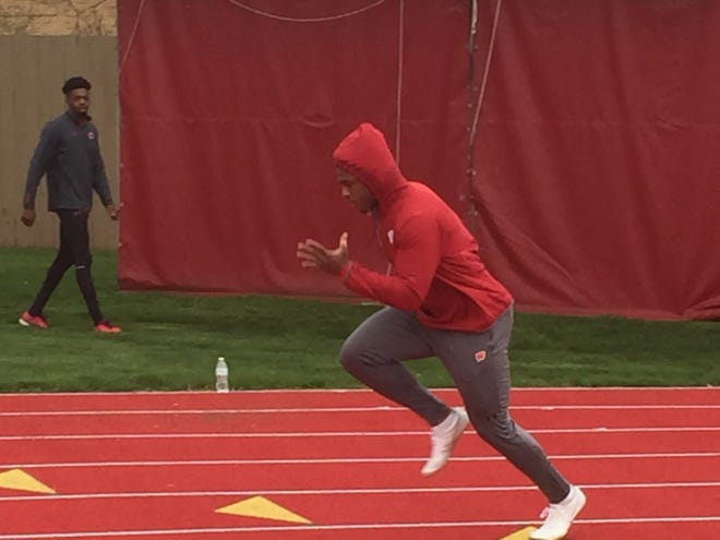 Wisconsin running back Jonathan Taylor works out at track practice.