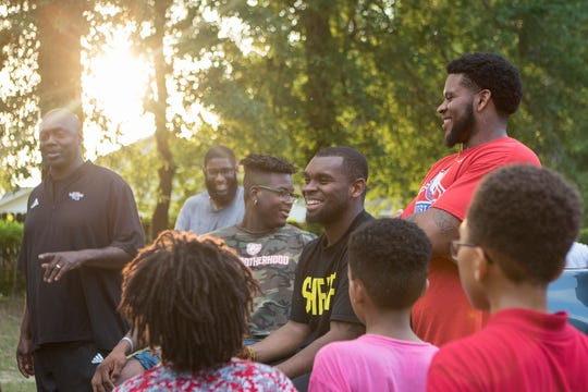 Courtney Wallace, center, smiles during a group talk at the end of the UPHY meeting, United Positive Humble Youth, a youth mentorship, in Ruston, La. on May 1. The meeting drew an estimated 50 kids from the community.