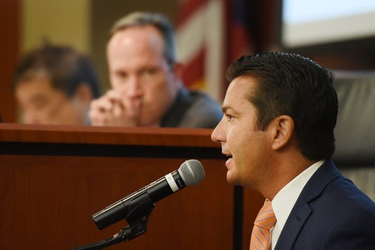 John Boyd, Principal of the Boyd Company, testifies as Jim Walden (rear), Special Counsel to the Task Force, listens during a public hearing on tax incentives at Baker Trial Courtroom of Rutgers Law School in Newark on 05/02/19. Gov. Phil Murphy's task force is investigating tax incentives meets as it seeks out fraud and abuse.