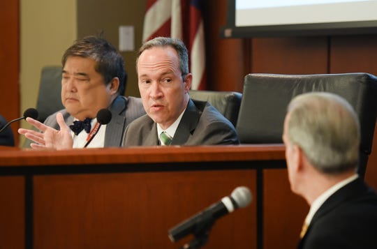 Jim Walden, Special Counsel to the Task Force, asks questions to Fred Cole (foreground), NJ EDA Senior Vice President of Operation, testifies during a public hearing on tax incentives at Baker Trial Courtroom of Rutgers Law School in Newark on 05/02/19. Gov. Phil Murphy's task force is investigating tax incentives meets as it seeks out fraud and abuse.