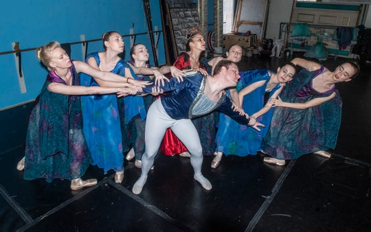 """The prince (Thaddeus Morris) gets pulled around by the Evil Queen (Rania Charalambidou) and her followers. Montgomery Ballet rehearsal for """"Snow White,"""" which will be performed Sunday, May 5, 2019, at Greenville High School."""