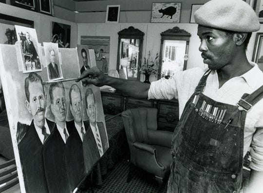 Montgomery artist Fishoe works on a painting on October 1, 1991 in Montgomery, Ala.
