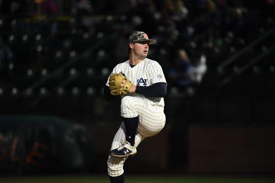 Auburn right-hander Tanner Burns pitches against Ole Miss on April 19, 2019, in Auburn, Ala.