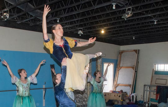 """Snow White (Brandy Carwhile) is lifted by the prince (Thaddeus Morris). Montgomery Ballet rehearsal for """"Snow White,"""" which will be performed Sunday, May 5, 2019, at Greenville High School."""