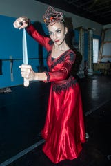 """Evil Queen (Rania Charalambidou) gets serious with a knife. Montgomery Ballet rehearsal for """"Snow White,"""" which will be performed Sunday, May 5, 2019, at Greenville High School."""