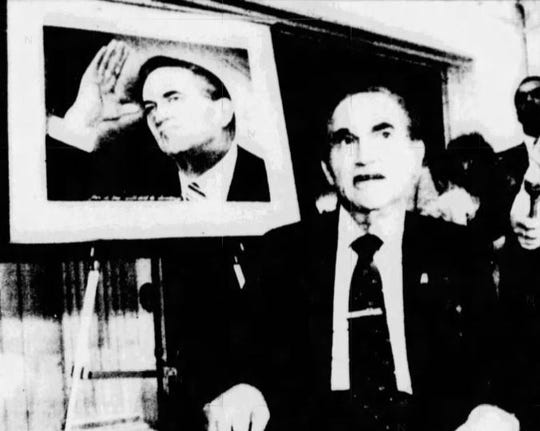 Gov. George Wallace with a portrait of himself painted by Zakee Fishoe. Fishoe was commissioned to do the portrait for Wallace's 67th birthday, his last in office.