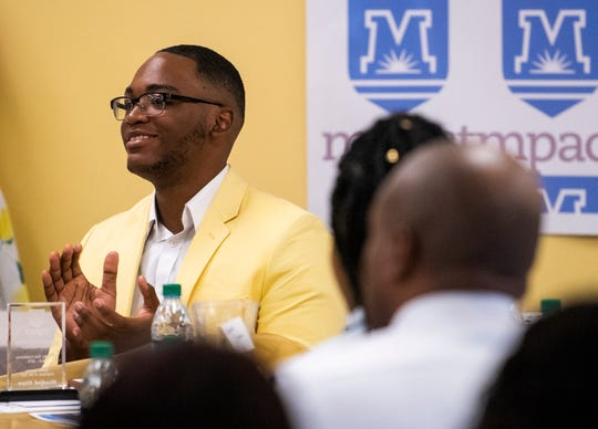Hezekiah Dixon claps as awards are handed out to fellow students during the MPACT end of the year awards ceremony held at the school in Montgomery, Ala., on Thursday May 2, 2019. Dixon was named the Health Science Employee of the Year and the MPACT Employee of the Year at the ceremony.