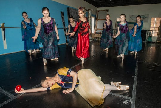 """Evil Queen (Rania Charalambidou) and her followers look down on the collapsed Snow White (Brandy Carwile). Montgomery Ballet rehearsal for """"Snow White,"""" which will be performed Sunday, May 5, 2019, at Greenville High School."""