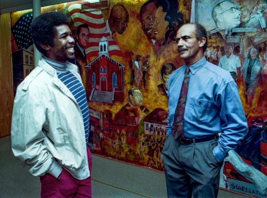 Montgomery artist Fishoe and John Feagin stand in front of the Civil Rights Mural in Dexter Avenue King Memorial Baptist Church on January 24, 1993 in Montgomery, Ala.